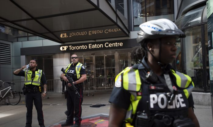 Toronto Police secure the scene where shots were fired during the Toronto Raptors NBA basketball championship parade in Toronto, on June 17, 2019. (Andrew Lahodynskyj/The Canadian Press via AP)