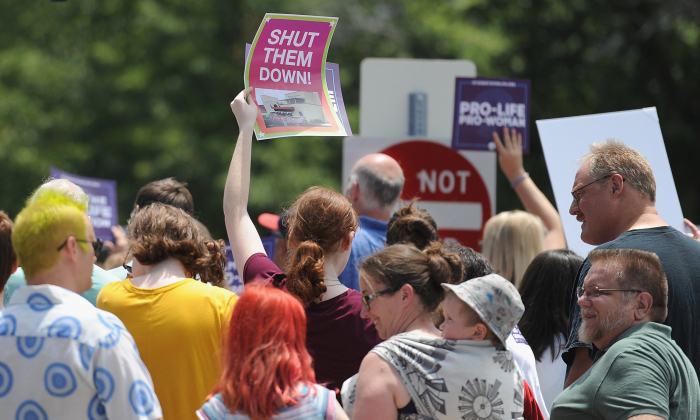A group of demonstrators display signs during a pro-life rally outside the Planned Parenthood Reproductive Health Center in St Louis, Missouri, on June 4, 2019. (Michael B. Thomas/Getty Images)