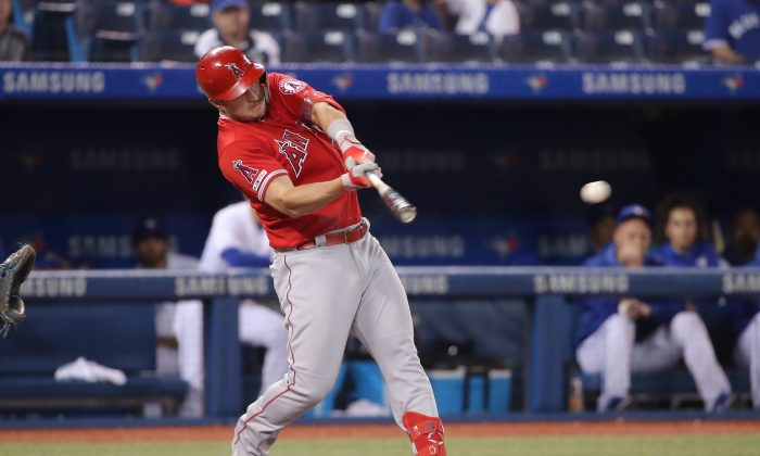 Mike Trout #27 of the Los Angeles Angels of Anaheim hits an RBI single in the ninth inning during MLB game action against the Toronto Blue Jays at Rogers Centre on June 19, 2019 in Toronto, Canada. Tom Szczerbowski/Getty Images