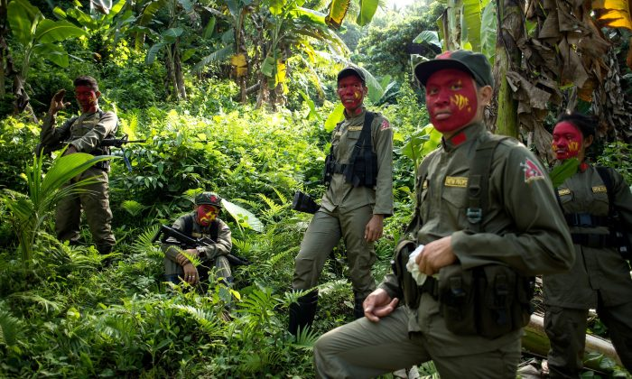 This photo taken on July 30, 2017 shows guerrillas of the New People's Army (NPA) resting among bushes in the Sierra Madre mountain range, located east of Manila. NOEL CELIS/AFP/Getty Images