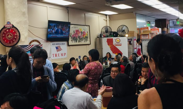 Asian Americans watch Trump's 2020 election bid announcement livestream on June 18, 2019. (Cynthia Cai/Epoch Times)