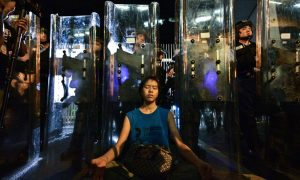 Interview With 'Shield Girl': The Story Behind an Iconic Image From Hong Kong Protests