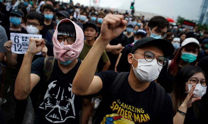 Protesters attend a demonstration demanding Hong Kong's leaders to step down and withdraw the extradition bill, in Hong Kong, China on June 17, 2019. (Athit Perawongmetha/Reuters)