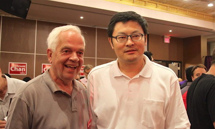 Liberal MP Geng Tan (R) and John McCallum, then a Liberal MP, attend a by-election victory party for Arnold Chan on June 30, 2014, in Toronto. (Becky Zhou/The Epoch Times)