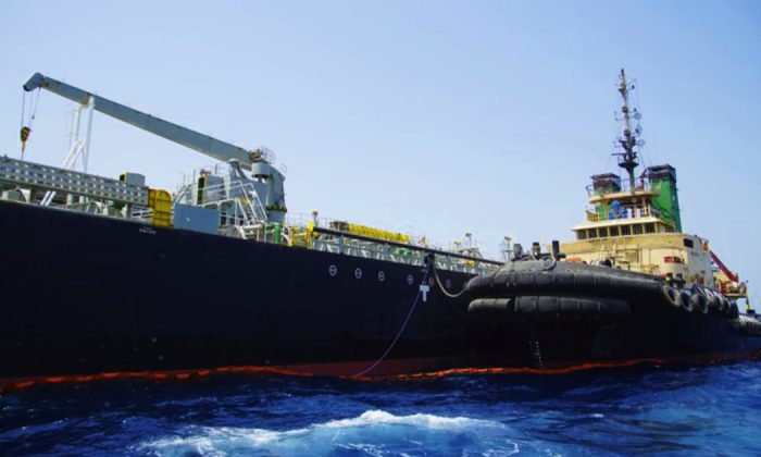 The Panama-flagged, Japanese owned oil tanker Kokuka Courageous, that the U.S. Navy says was damaged by a limpet mine, is anchored off Fujairah, United Arab Emirates on June 19, 2019. (Fay Abuelgasim/AP)