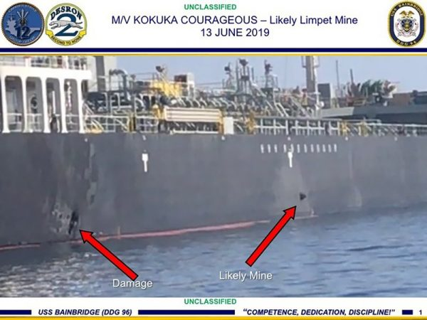 The damage and a suspected mine on the Kokuka Courageous in the Gulf of Oman