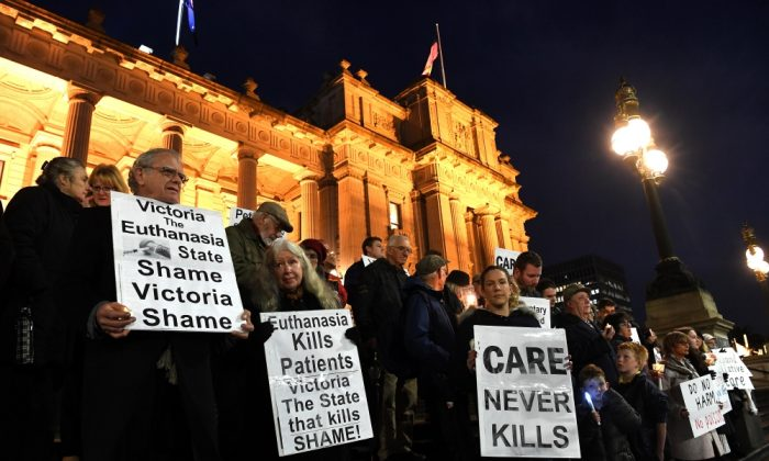 Pro-life demonstrators gather outside the Victorian State Parliament, opposing the progressive government's euthanasia laws in Melbourne on June 18, 2019. (James Ross/AAP Image via AP)