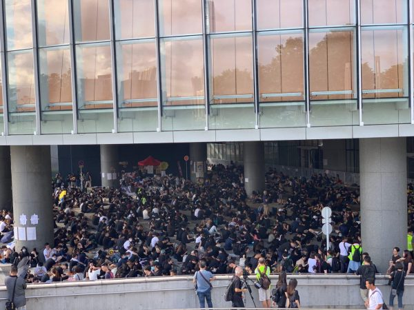 protesters gather outside of the Hong Kong government buildings