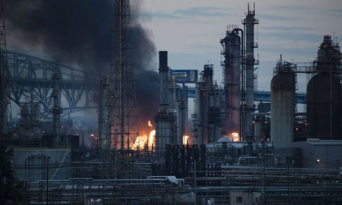 Flames and smoke emerge from the Philadelphia Energy Solutions Refining Complex in Pa., on June 21, 2019. (Matt Rourke/AP)