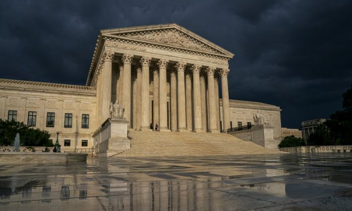 The Supreme Court is seen under stormy skies in Washington on June 20, 2019. (J. Scott Applewhite/AP)