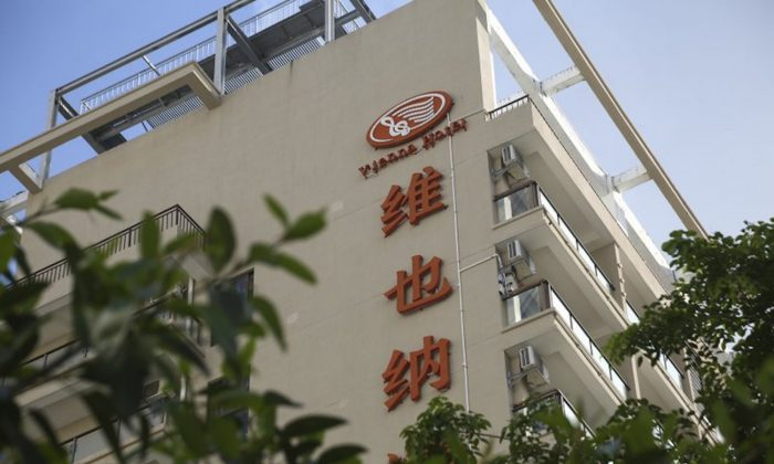 """A Vienna International Hotel in Sanya City in southern China's Hainan Province is seen on June 20, 2019. The hotel chain is amongst 84 names listed by the Civil Affairs Department in Hainan whose names are in need to be """"cleaned up"""" due to various reasons including """"worship and have blind faith in foreign things."""" China is cracking down on """"foreign"""" names under a new campaign, stirring controversy amid a government-backed tide of rising nationalistic sentiment. (Chinatopix via AP)"""
