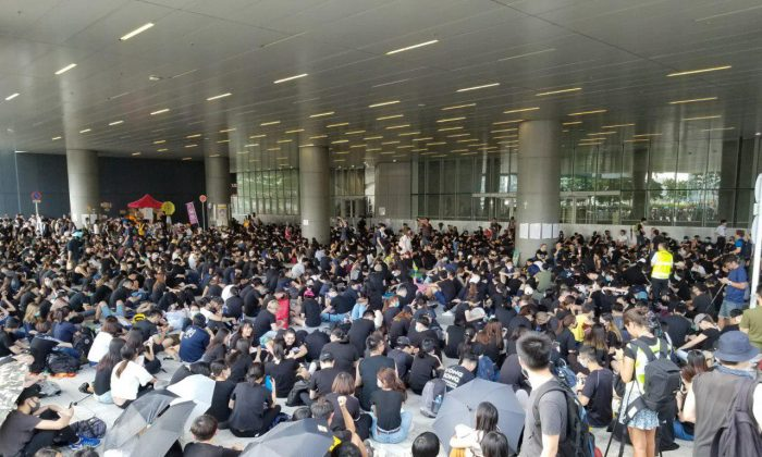 Protesters gather outside of Hong Kong Legislative Council on the morning of June 21, 2019. (Song Bilong/The Epoch Times)