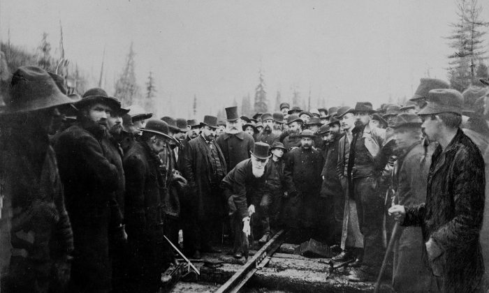 "Canadian Pacific Railway director the Hon. Donald A. Smith drives home the symbolic ""last spike"" in a ceremony marking the completion of the railway in Craigellachie, B.C., on Nov. 7, 1885. (THE CANADIAN PRESS/National Archives of Canada)"