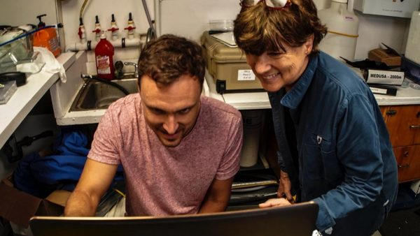 Dr. Nathan Robinson and Dr. Edie Widder view giant squid footage