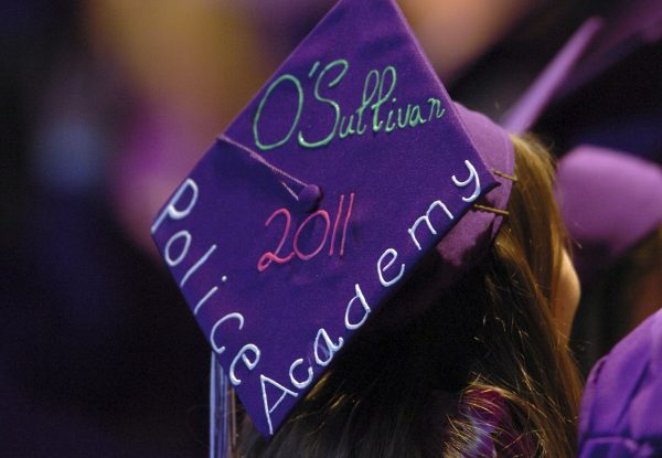 Tara O'Sullivan decorated her mortar board with her police academy plans