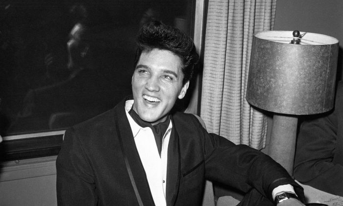 Singer Elvis Presley smiles during a press conference inside his private railroad car at Los Angeles Union Station, California, United States in April 20, 1960. (AP Photo/HPM)