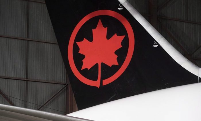 The tail of an Air Canada Boeing 787-8 Dreamliner aircraft is seen at a hangar at the Toronto Pearson International Airport in Mississauga, ON., on February 9, 2017. (Mark Blinch/The Canadian Press)