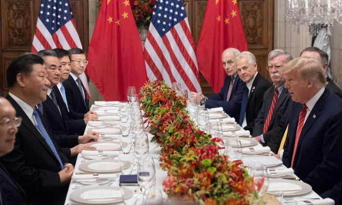 U.S. President Donald Trump (R) and Chinese leader Xi Jinping (L) along with members of their delegations, hold a dinner meeting at the end of the G-20 Leaders' Summit in Buenos Aires, on Dec. 1, 2018. (SAUL LOEB/AFP/Getty Images)