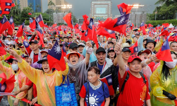 Supporters of Kaohsiung city mayor Han Kuo-yu, who has joined the race to become Taiwan's next president in 2020, wave Taiwanese flags during a campaign event in Taipei on June 1, 2019. (Daniel Shih/AFP/Getty Images)