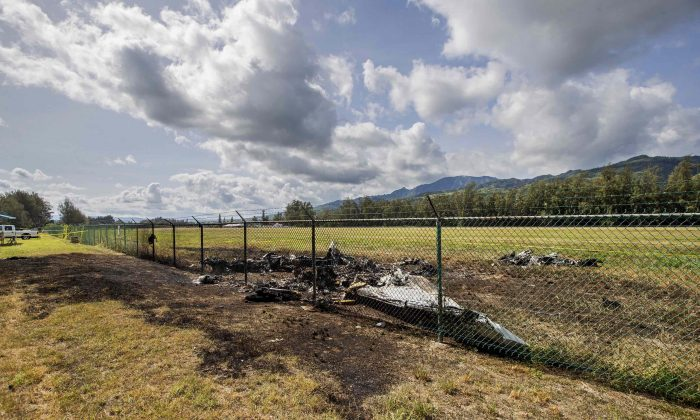 Site where the King Air twin-engine plane crashed at the fence line at Dillingham Airfield in Mokuleia, Hawaii, killing 11 people. (Dennis Oda/Honolulu Star-Advertiser via AP)