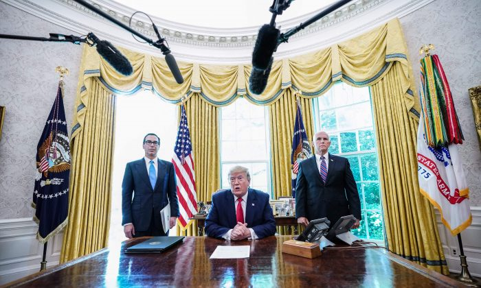 """President Donald Trump meets with Vice President Mike Pence (R) and Secretary of Treasury Steven Mnuchin at the White House on June 24, 2019, before signing """"hard-hitting sanctions"""" on Iran's supreme leader. (MANDEL NGAN/AFP/Getty Images)"""