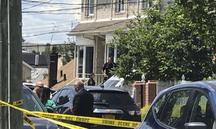 New York Police Department officers investigate what is being treated as a triple homicide on Staten Island, N.Y., on June 22, 2019. (Irene Spezzamonte/Staten Island Advance via AP)