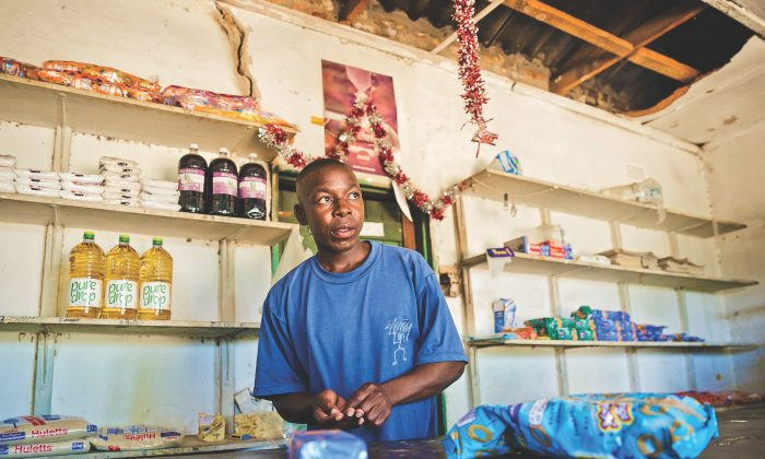 Solomon Chakauya, who says people have no money to buy the things they would wish to buy, waits for customers in his grocery store in Chinamhora, Zimbabwe, on Dec. 10, 2018.  (JEKESAI NJIKIZANA/AFP/Getty Images)