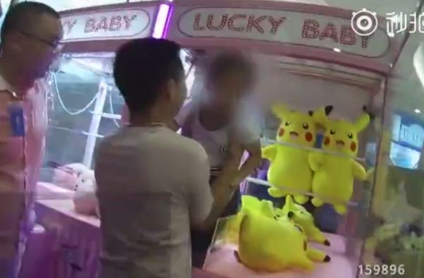 Girl claw machine pikachu