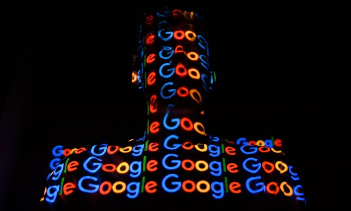 The Google logo is projected onto a man on in London on Aug. 9, 2017. (Leon Neal/Getty Images)