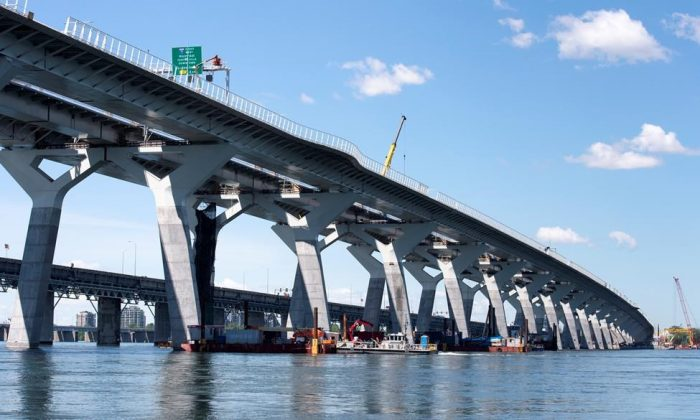 The new Samuel de Champlain bridge is seen with the old bridge in the background in Montreal on June 17, 2019. (Paul Chiasson/The Canadian Press)