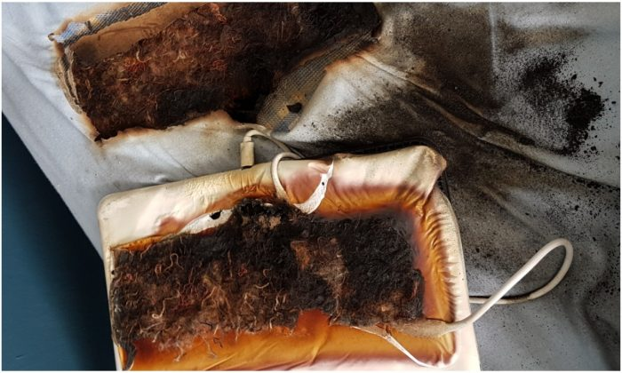 A picture of a melted and burned tablet and mattress, which occurred when the device was left plugged in for over 24 hours, according to Staffordshire Fire and Rescue Service, on June 19, 2019. (SFRS)