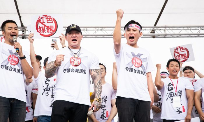 The two organizers, Holger Chen Huang (L) and Kuo-chang (R) at the mass rally in protest of the pro-Beijing media in Taipei, Taiwan, on June 23, 2019. (Chen Bozhou/The Epoch Times)