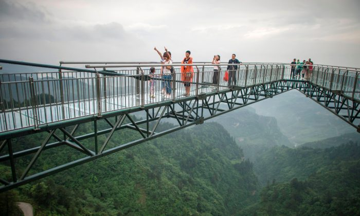 Tourists in Wansheng park, China. (Fred Dufour/AFP/Getty Images)