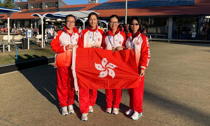 (L-R) Gloria Ha, Cheryl Chan, Angel So and Phyllis Wong flying the flag for Hong Kong after winning a bronze in the women's fours at the Asia Pacific Championships in Gold Coast, Australia, last Friday, June 21. (Hong Kong Lawn Bowls Association)