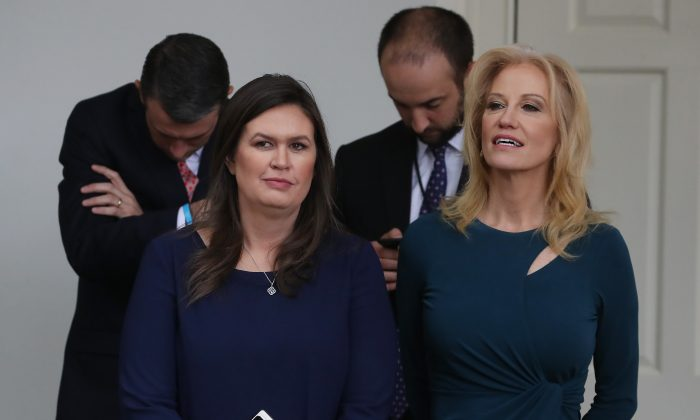 White House press secretary Sarah Sanders (L) and White House counselor Kellyanne Conway (R) listen to President Donald Trump speak in the Rose Garden at the White House on May 22, 2019.  Mark Wilson/Getty Images