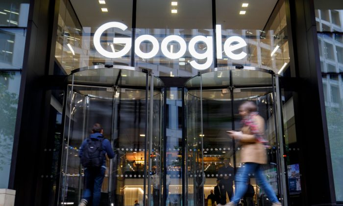 People walk past Google's UK headquarters in London on Nov. 1, 2018. (Tolga Akmen/AFP/Getty Images)