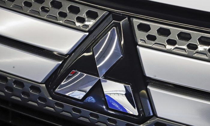 The Mitsubishi logo on the front grill of a 2019 Mitsubishi Outlander GT on display at the 2019 Pittsburgh International Auto Show in Pittsburgh on Feb. 14, 2019. (AP Photo/Gene J. Puskar, File)