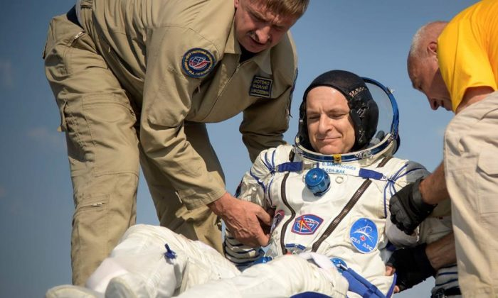 In this photo provided by NASA, Expedition 59 astronaut David Saint-Jacques of the Canadian Space Agency (CSA) is helped out of the Soyuz MS-11 spacecraft just minutes after he, NASA astronaut Anne McClain, and Roscosmos cosmonaut Oleg Kononenko, landed in a remote area near the town of Zhezkazgan, Kazakhstan on June 25, 2019.  (Bill Ingalls/NASA via AP/The Canadian Press)