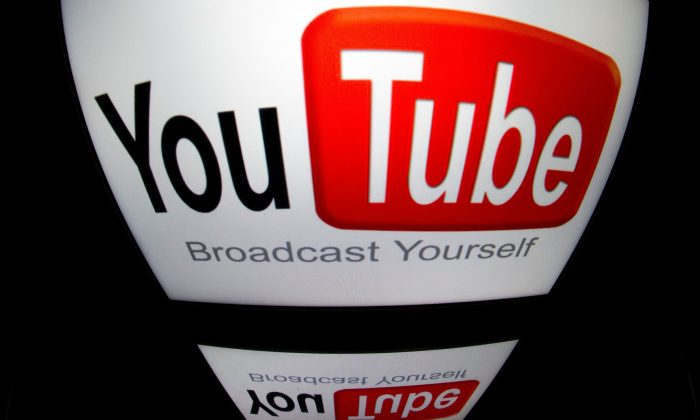 "The ""YouTube"" logo on a tablet in Paris, France, on Dec. 4, 2012. (Lionel Bonaventure/AFP/Getty Images)"