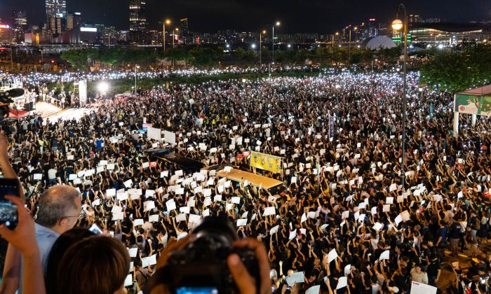 Thousands of protesters take part in a rally against a controversial extradition bill ahead of the G-20 summit, at Edinburgh Place in Central district, Hong Kong, on June 26, 2019. (Li Yi/The Epoch Times)