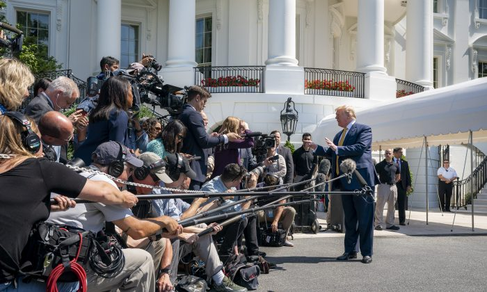 President Donald Trump speaks with reporters on the South Lawn of The White House on June 22, 2019. (Official White House Photo by Tia Dufour)