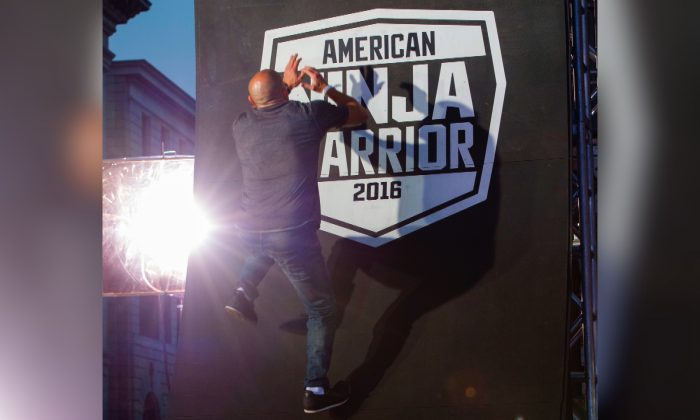 "A competitor climbs the last wall of the challenge at the ""American Ninja Warrior"" screening and course demonstration In celebration of the show's first Emmy Award nomination, at Universal Studio, in Universal City, Calif., on Aug. 24, 2016. (Valerie Macon/AFP/File photo via Getty Images)"