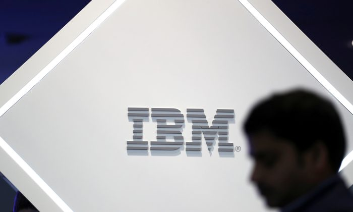 A man stands near an IBM logo at the Mobile World Congress in Barcelona, Spain on Feb. 25, 2019.      (Sergio Perez/Reuters)