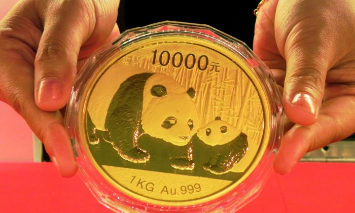 A golden panda ingot in Hangzhou, China in a file photo. The price of gold has recently surged for a number of reasons including people seeking to protect their wealth against financial turmoil amid speculation that the global economy is slowing. (VCG/VCG via Getty Images)