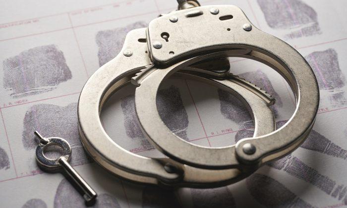 Handcuffs in a file photograph. (Bill Oxford/Unsplash)