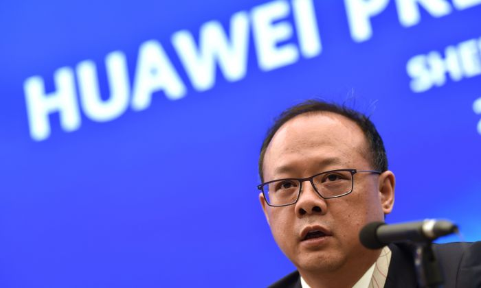 Vincent Pang, Head of Corporate Communications of Chinese tech giant Huawei speaks during a press conference at the Huawei facilities in Shenzhen, Guangdong province on May 29, 2019. (HECTOR RETAMAL/AFP/Getty Images)