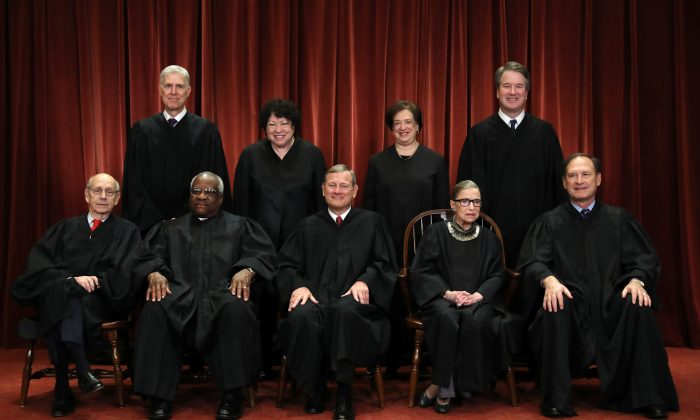 (Front L–R) U.S. Supreme Court justices Stephen Breyer, Clarence Thomas, John Roberts, Ruth Bader Ginsburg, Samuel Alito, (Back L–R) Neil Gorsuch, Sonia Sotomayor, Elena Kagan, and Brett Kavanaugh at the Supreme Court building on Nov. 30, 2018.  (Chip Somodevilla/Getty Images)
