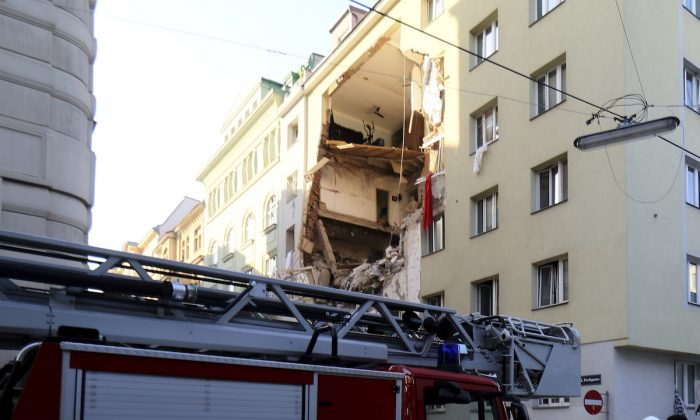 Firefighters search through the rubble of a exploded building in Vienna, Austria, on June 26, 2019. (Ronald ZakAP Photo)