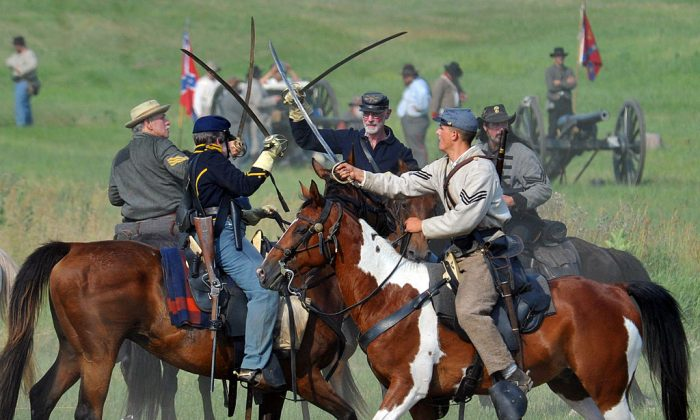 Union cavalry troops engage Confederate cavalry with sabers during the Battle at the Sherfy House on July 2, 2011 during re-enactments of battles at the Gettysburg National Military Park in Pennsylvania. (KAREN BLEIER/AFP/Getty Images)
