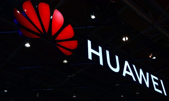 The Huawei logo is displayed at the 2018 CeBIT technology trade fair in Hanover, Germany, on June 12, 2018. (Alexander Koerner/Getty Images)